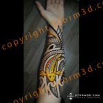 inner forearm with maori koifish design in yellow
